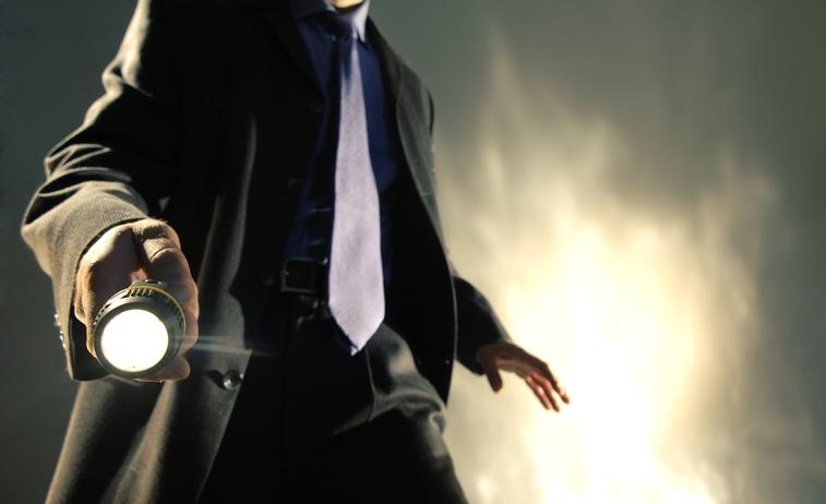 Private investigator holding a flashlight