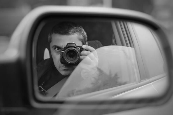 private investigator performing photo surveillance