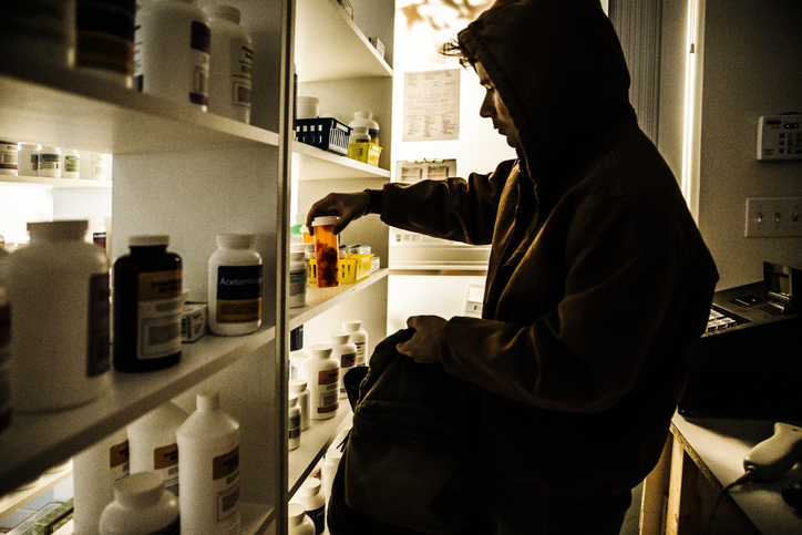 A young male stealing prescriptions