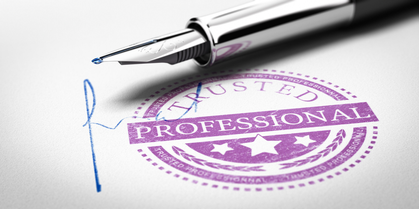 Trusted Professionnal rubber stamp mark imprinted on a paper texture with signature and fountain pen