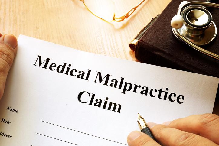 Medical Malpractice Claim on a table